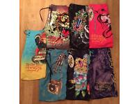 7 pairs of brand new authentic Ed Hardy and Christian Audigier men's swim shorts. Waist 32/33