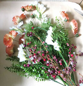 A selection of artificial flowers and foliage. Poppies, Freesia's, fern, berries and other foliage