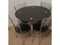 Chrome & black glass dinning table & 4 matching chairs