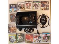 Sony PlayStation PS3 with two controllers, controller charger stand and lots of games