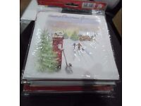 10 packs of Christmas cards each pack contains 2 designs and 10 cards