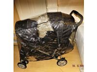 double pram ,black suitable for two toddlers or baby and toddler,g w o,folds flat , has raincover ,