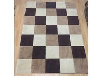 Large brown chequed rug