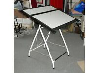 Drawing table adjustable/tiltable