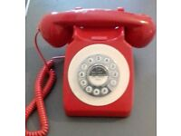 Retro corded home telephone red.