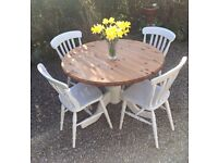 Solid Pine pedestal table & 4 chairs