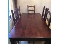 Solid oak dining table and 6 chairs ( can deliver )