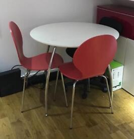 Round Dining Table and Red Chairs