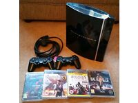 Playstation 3 with 2 Controllers and 4 Games