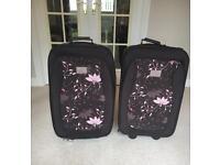 2 Medium Suitcases