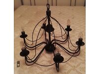 6 branch black iron light fitting with ceiling hook fixture. beautiful condition and very stylish