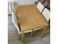 Solid wood table + 4 cream faux leather chairs