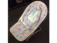 Blue baby bouncer and baby blanket