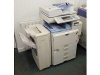 Ricoh Afico MP C3500 Colour Photocopier and paper sorter/handler.