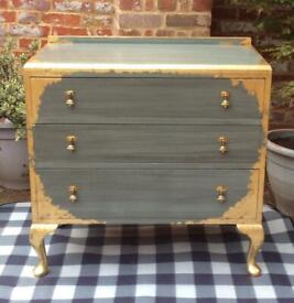 Wooden French style chest of drawers with gold leaf and brass tear drop handles