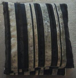 4 black and grey cushions