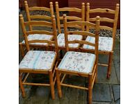 5 dining chairs. Light pine wood farmhouse style. Cushioned upholstery seat. In excellent condition.