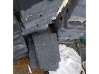 35 or so charcoal driveway bricks from Travis perkins