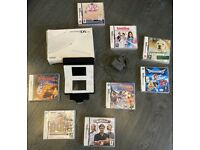 White Nintendo DS lite with 8 games