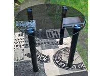 Ex-display Lunar Black Glass Dining Table.
