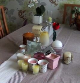 Selection of nineteen different candles and candle holders.All in good condition.