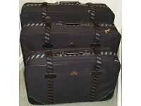 Luggage - set of three matching suitcases in very good condition