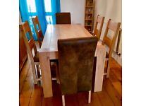 Large solid oak dining table & 6 chairs.