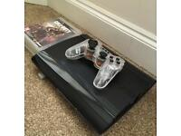 PlayStation 3 with wireless controller & four games.