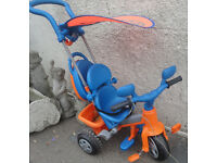 USED CONDITION, A NICE FEBER KIDS TRIKE WITH DETACHABLE CARRY CASE