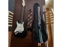 Electric Guitar (left handed) with case and strap. Lindo