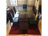 Dining-room Glass Table with 8 black leather chairs