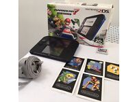 Blue Nintendo 2ds with Mario Cart 7 and Asphalt game