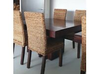 Mango wood dining tables and wicker chairs