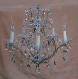 """""""Laura Ashley"""" chrome and crystal five arm chandelier."""