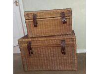 Two wicker storage baskets