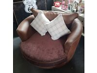 Beautiful brown swivel cuddle chair
