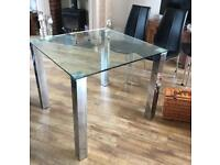 X4 modern black chairs and glass table
