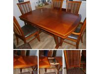 VERY NICE. TABLE AND 6 CHAIRS.