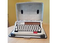 Brother Deluxe 1510 portable typewriter and case.