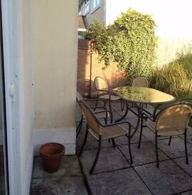 Garden glass top table and six matching chairs