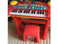 Kids toy piano and stool