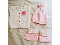 Hand knitted set of one sleeves less cardigan, hat and bootees for 3-6 months baby