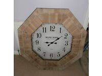 Natural oak wall clock.