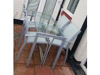 metal and glass garden table and chairs