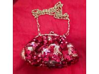 Red shoulder / clutch bag with detachable chain strap.