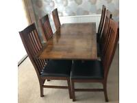 Dining table and six chairs in excellent condition