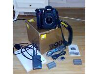 Nikon D90 Digital Camera with Nikon 18-55 lens and Nikon MB-D80 grip and two batteries