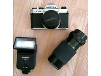 Pentax K1000 body + 2 lenses, a battery operated flash unit and some accessories