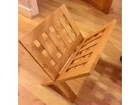 Pine coloured wooden magazine rack in get good condition. Slots together.