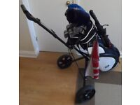 Set of Wilson golf clubs, Masters bag and trolley